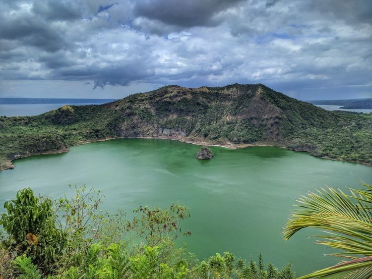 Taal Volcano Crater Lake ASIA Batangas Beauty In Nature Cliff Cloud Burst Crater Crater Lake Horizon Over Water Lake Landscape Manila Mountain Nature Outdoors Philippines Physical Geography Rain Scenics Sky Southeastasia Taal Volcano Travel Destinations Volcano Water EyeEmNewHere Neighborhood Map