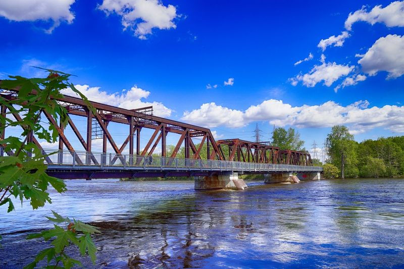 Architecture Blue Bridge - Man Made Structure Built Structure Cloud - Sky Connection Day Engineering Nature No People Outdoors Reflections In The Water River Riverside Sky The Architect - 2017 EyeEm Awards Transportation Tree Water