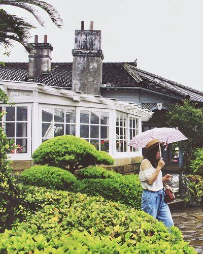 Rain in Japan Japan Photography Travel Destinations Rainy Days Garden Adventure Nagasaki JAPAN Fashion Lifestyles EyeEmNewHere Architecture Day Outdoors Adult Built Structure People Women Plant First Eyeem Photo