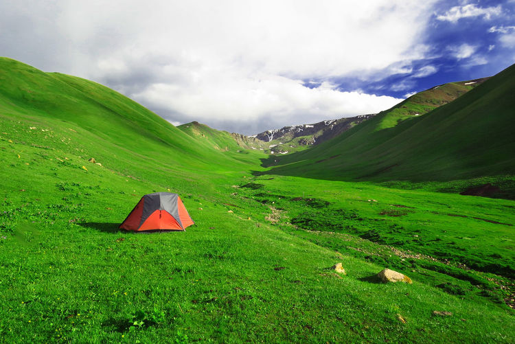 Freedom Lifestyle Trekking Adventure Beauty In Nature Camping Camping Into The Wild Cloud - Sky Grass Green Color Gren Hills Landscape Mountain Mountain Range Nature No People Outdoors Red Tent Scenics Sky Tent Tentacle Tranquil Scene Tranquility Trekking In Kyrgyzstan