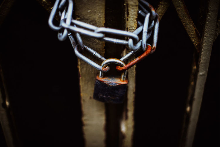 High Angle View Of Rusty Chain And Padlock On Gate
