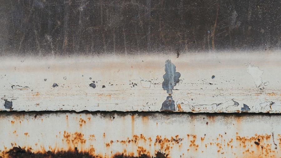 Rusty metal on wall