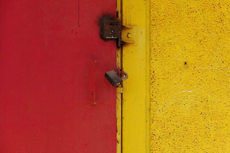 Close-Up Of Locked Red Door