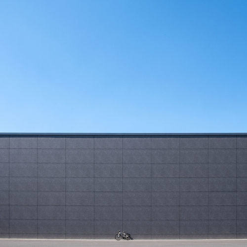 Sky Clear Sky Architecture Building Exterior No People Built Structure City Outdoors Building Copy Space Blue Modern Wall - Building Feature Pattern Clean Bycicle