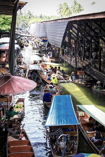 the hustle bustle at the floating market Bangkok Thailand Adult Architecture Boats Building Exterior Built Structure Day Floating Market Dumnoen Saduak High Angle View Large Group Of People Longtail Boat Men Outdoors People Real People Water Wooden Boats