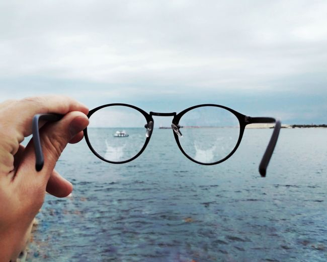 Live For The Story Human Body Part Eyeglasses  One Person People Human Hand Adults Only Holding Adult Day Outdoors One Man Only Cloud - Sky Eyesight Only Men Sky Sea Close-up The Great Outdoors - 2017 EyeEm Awards EyeEmNewHere Beauty In Nature Horizon Over Water Nature Sommergefühle