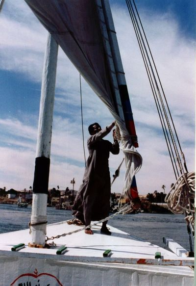 Boat Boats Cloud - Sky Egypt. Felucca Felucca Boat. Man Man Standing Man Standing On Deck Of Felucca Men Mode Of Transport Nautical Vessel Sail. Sea Sky Standing Transportation Travel Water Connected By Travel
