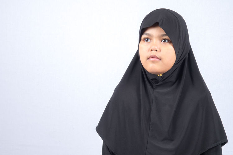 Girl Wearing Hijab Over White Background