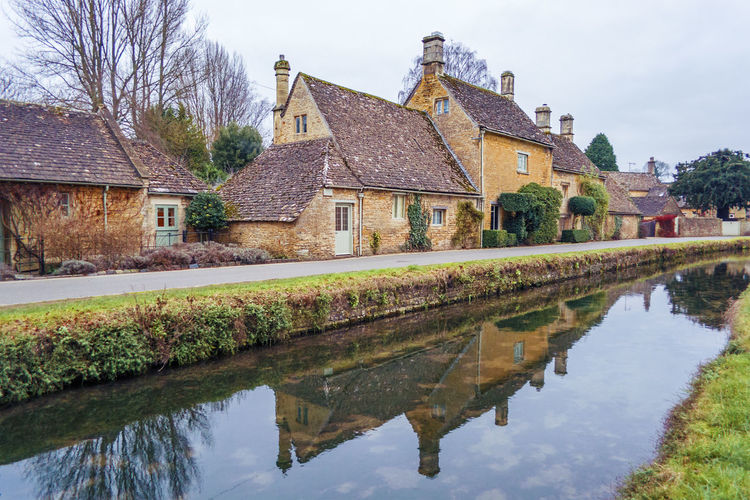 Lower Slaughter near Bourton on the Water in the Cotswolds in England Built Structure Village Dusk Evening Home Facade Building Cotswold Cotswolds Bourton On The Water Lower Slaughter Tree House Building Reflection Water Building Exterior Architecture England Uk United Kingdom
