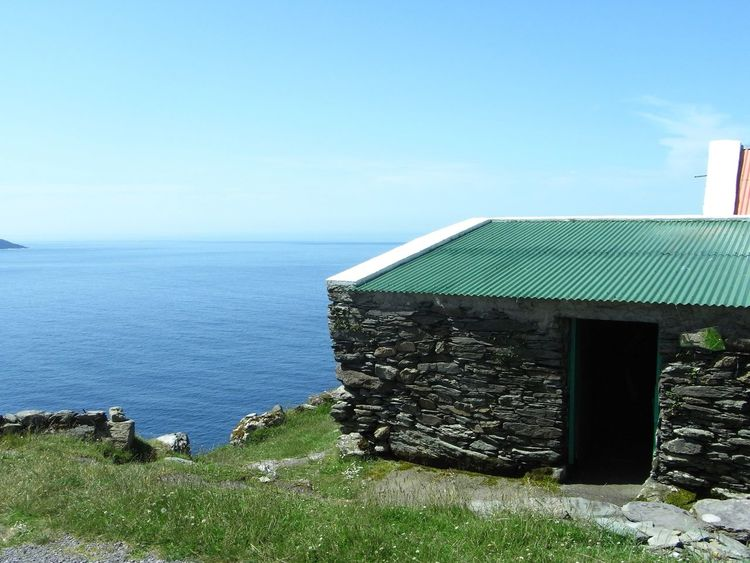 A very calm Atlantic oceanOcean View Atlantic Ocean Blue Sea Blue Sky Calm Sea Farm Buildings Shed Stone Wall Corrugated Iron ClifftopSheep's Head Way Wildatlanticway Ireland Been There.