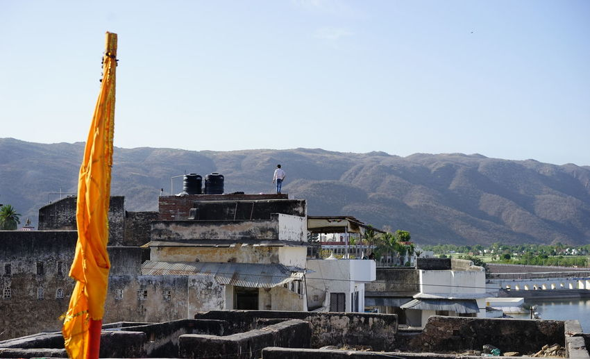 Pushkar Beauty In Nature Day Flag Man On Rooftop Mountain Mountain Range Outdoors Lost In The Landscape