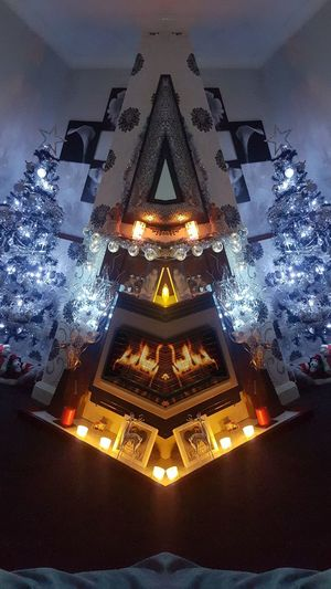 Illuminated Christmas Tree Night Festive Abstract Photography Cossy Fireplace Christmas Lights Warmth Candles Tea Lights Mirror Image Mirror Reflection Living Room Indoors