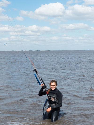 Portrait of female kitesurfer