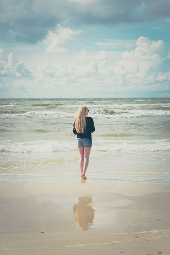 Baltic Sea Latvia Reflection Beach Beauty In Nature Blond Hair Cloud - Sky Full Length Girl Hair Horizon Horizon Over Water Land One Person Outdoors Real People Rear View Sand Sea Sky Standing Summer Vacations Water Young Adult