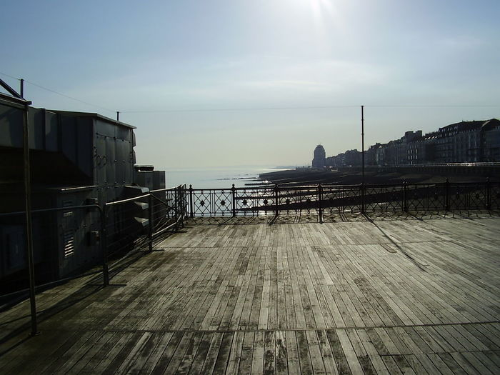Pier Sun Dazzle Outdoors Sea Bridge - Man Made Structure Sunlight Sky No People Day Horizon Over Water Architecture City