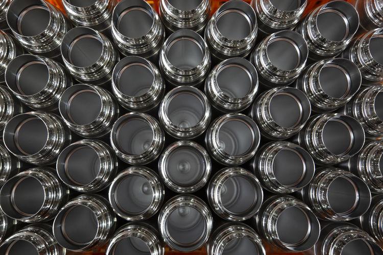Full frame shot of metal bottles