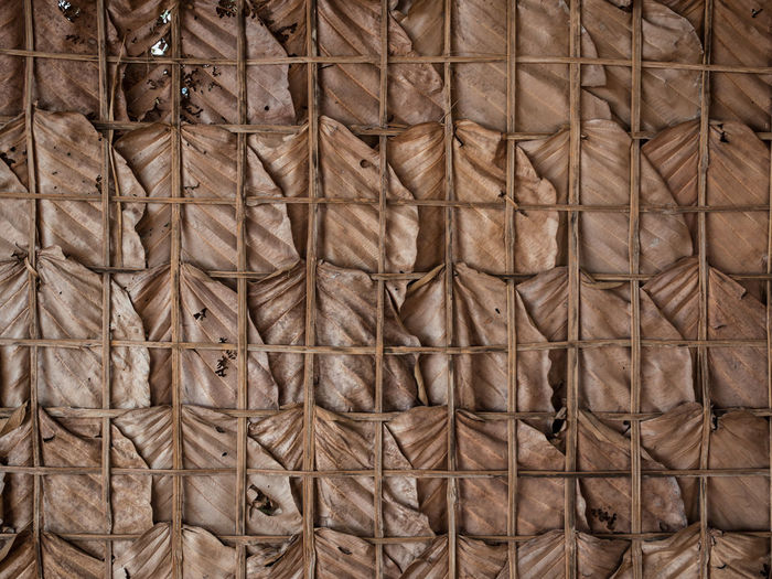 Traditional wall made of dry leaves Backgrounds Brown Full Frame Close-up Pattern Textured  No People Man Made Material Man Made Object Basket Container Textile Wicker Industry Wood - Material Abstract Rough Abstract Backgrounds Wood Grain Dry Leaves