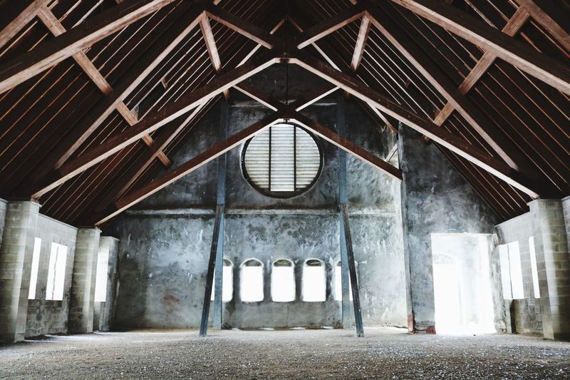 The Old Stone Church EyeEm Selects Built Structure Building Ceiling Indoors  No People Old Abandoned Wall Roof Weathered Low Angle View Roof Beam Window Architectural Column