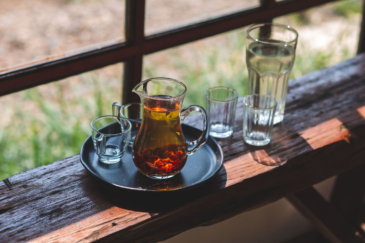 Drink hot tea in a beautifully prepared glass jug ready to serve.