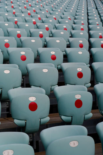 Rows of empty seats in an auditorium