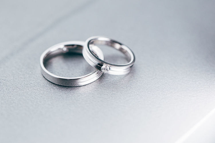High angle view of platinum wedding rings on table