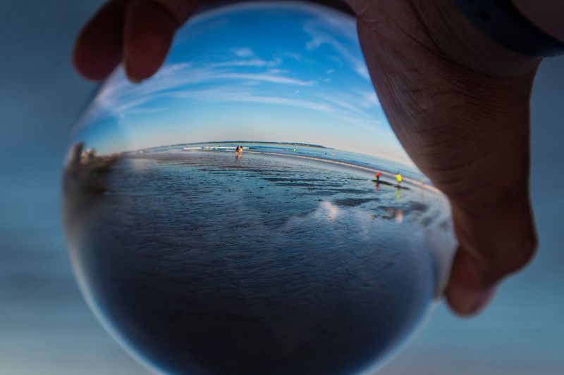Life's Perspective East Coast Atlantic Atlantic Ocean Maine Blue Photography Photo Photo Of The Day Glass Ball Ball Glass Beach Beauty Beauty In Nature Hand One Person Close-up Blue Nature Water Men Sea Real People Unrecognizable Person Day Outdoors Front View Reflection Digital Composite Lifestyles