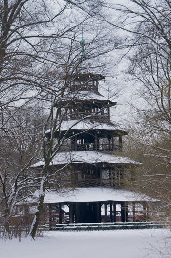 Chinese Tower in English Garden in the Snow (April!) Abundance Beer Garden Build Structure Chinese Tower Melancholic No People Snow Trees White Color Winter
