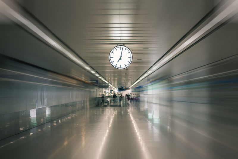 Time Clock Transportation Indoors  Architecture Illuminated Blurred Motion Travel Railroad Station Clock Face Motion Mode Of Transportation Public Transportation Incidental People Built Structure Rail Transportation Corridor Wall - Building Feature Arcade Transportation Building - Type Of Building Minute Hand Ceiling Wall Clock