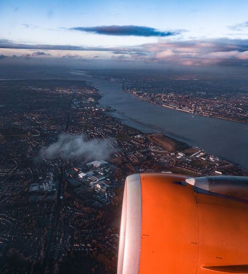 Aerial view of cityscape and jet engine