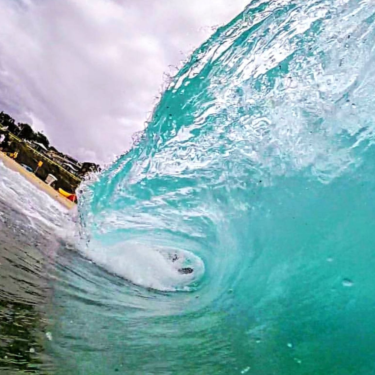 water, motion, sea, wave, sport, nature, power in nature, sky, aquatic sport, splashing, power, day, surfing, outdoors, beauty in nature, cloud - sky, people, turquoise colored, flowing water
