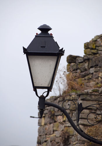 Steet lamp over antique stone wall Antique Gloomy Gloomy Day Kamenets-Podolsky Lamp Lantern Light Post Stone Street Wall Weather