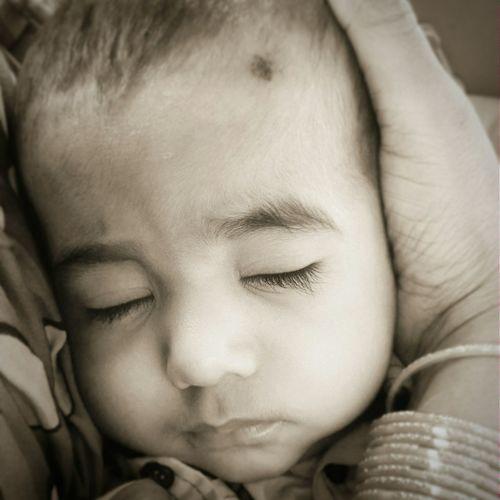 Thats my lil nephwe (just FYI)... Babyboy rehan fast asleep...