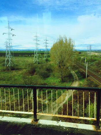 Tree Railing Sky Nature Day Electricity Pylon No People Tranquility Connection Grass Outdoors Landscape Beauty In Nature