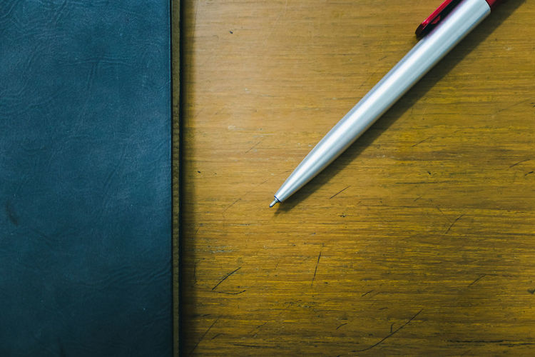 Antique Blue Book Close-up Directly Above Education Fountain Pen High Angle View Ideas Indoors  Metal No People Notebook Office Pen Pencil Silver Colored Still Life Table Tabletop Two Objects Wood - Material Writing Instrument