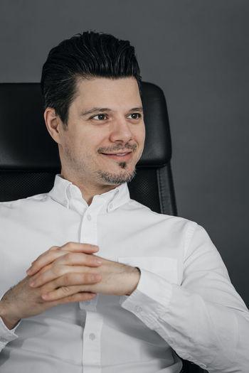 Every boss needs a proper profile pic. Businessman Well-dressed Collar Men Business Studio Shot Handsome Portrait Black Hair Vanity Menswear Thinking Formal Portrait