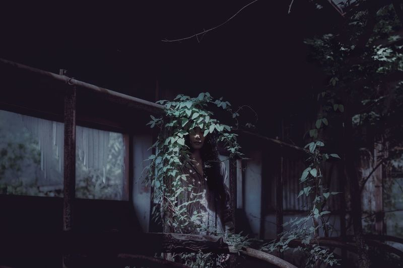 Low angle view of abandoned building at night