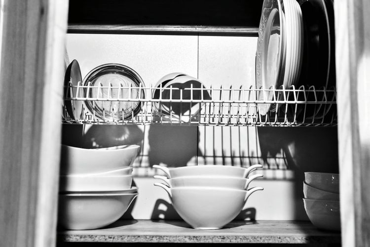 Close-up of kitchen utensils in shelf at home