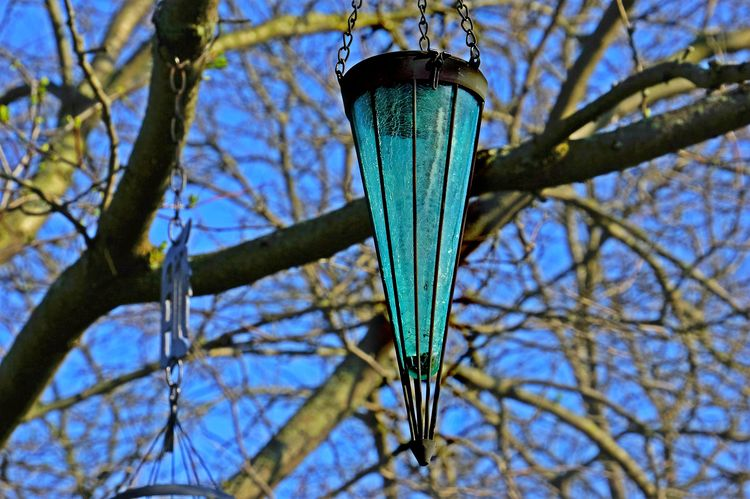 Blue Sun Catcher Blue Blue Glass Close-up Cracked Glass Day Focus On Foreground Growth Hanging Hung Low Angle View Nature No People Ornament Outdoors Pole Selective Focus Sky Sun Catcher SunCatcher  Tranquility Transparent Tree Tree Trunk Twig Vase