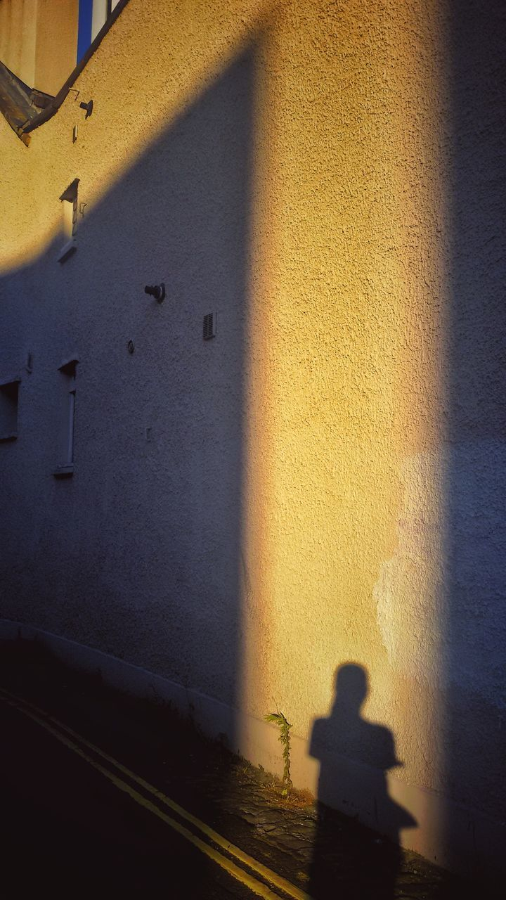 architecture, built structure, shadow, yellow, building exterior, window, real people, outdoors, day