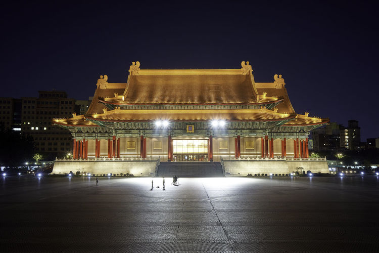 Illuminated national concert hall building at night