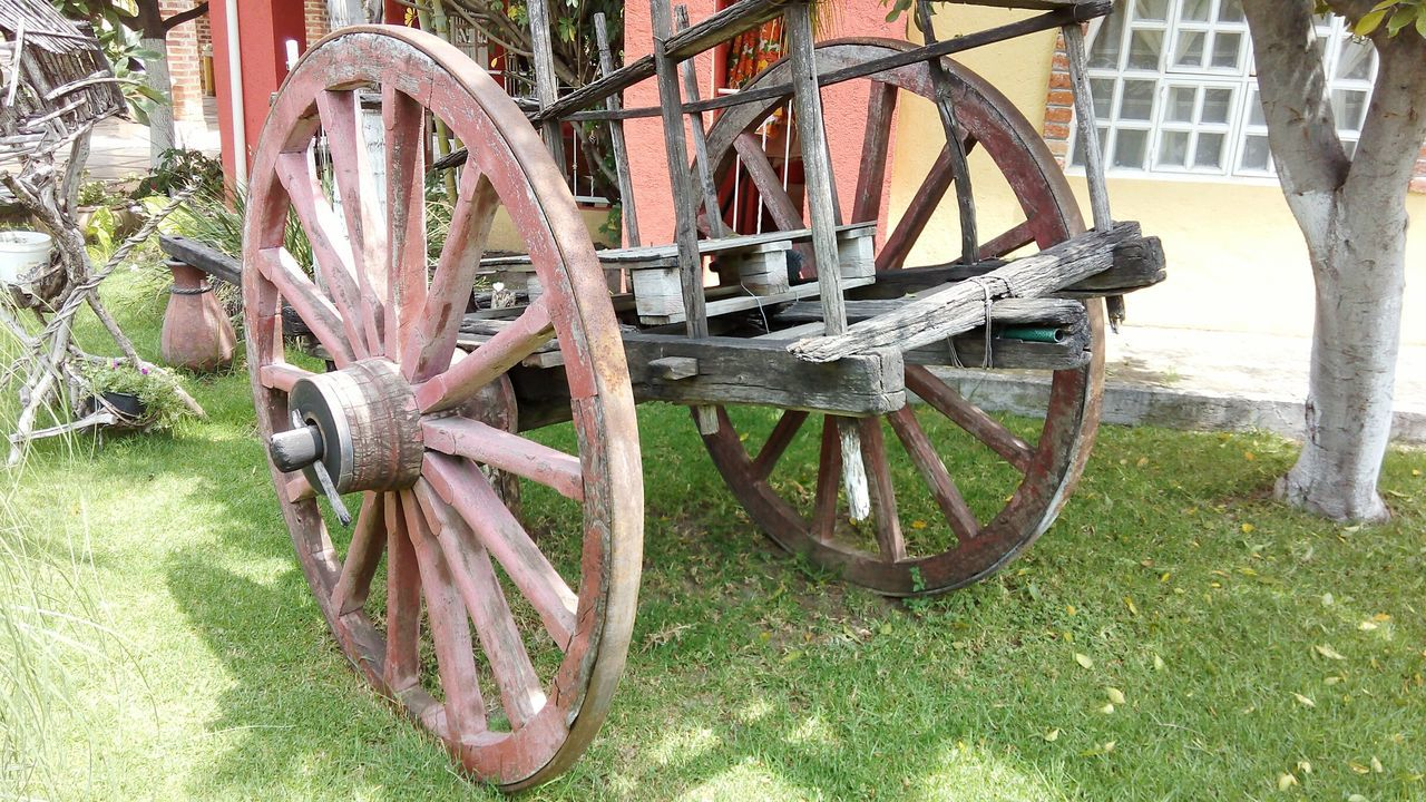 wheel, wagon wheel, old-fashioned, transportation, horse cart, no people, day, stationary, outdoors, field, grass