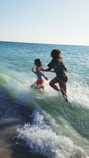 Sea Water Beach Leisure Activity Vacations Togetherness Enjoyment Horizon Over Water People Sky Sunlight Girls Bonding Child Two People Beach Life Beach Day Beachphotography Fun In The Sun Memories Childhood Blue Sisters Sisterly Bonding Sisterly Love