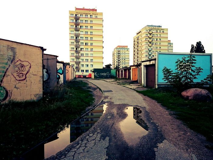 Streetphotography Urban Landscape Highrises Garages Street Graffiti Street Art After The Rain Evening In The City Bydgoszcz, Poland  Water Reflection Puddle Reflections Colour Play Empty Street The Week Of Eyeem