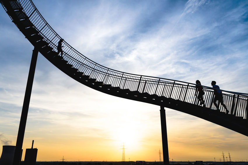 Stairway to heaven Silhouette Sunset Outdoors Cloud - Sky Sky Sundown Sunset Silhouettes Evening Mood People Art Tiger & Turtle Tiger And Turtle – Magic Mountain Tiger And Turtle Construction Industrial Fine Art First Eyeem Photo Dramatic Sky Art And Craft Steel Up Sport Fineart Jogging Colour Your Horizn Visual Creativity The Architect - 2018 EyeEm Awards