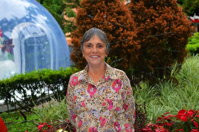 Portrait Of Senior Woman Standing Against Plants At Park