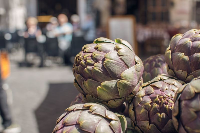 Close-up of artichokes in market for sale