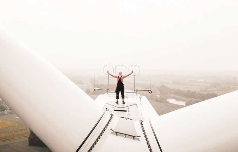 - #FREIHEIT SUSTAINABLE - The Portraitist - 2018 EyeEm Awards Check This Out DJI X Eyeem EyeEm Best Shots Wind Power Architecture Arms Raised Building Exterior Built Structure Copy Space Day Drone Photography Dronephotography Full Length Human Arm Leisure Activity Lifestyles Men Nature One Person Outdoors Real People Rear View Sky Standing Wind Power Generator #FREIHEITBERLIN The Great Outdoors - 2018 EyeEm Awards #urbanana: The Urban Playground Be Brave 50 Ways Of Seeing: Gratitude 2018 In One Photograph Humanity Meets Technology