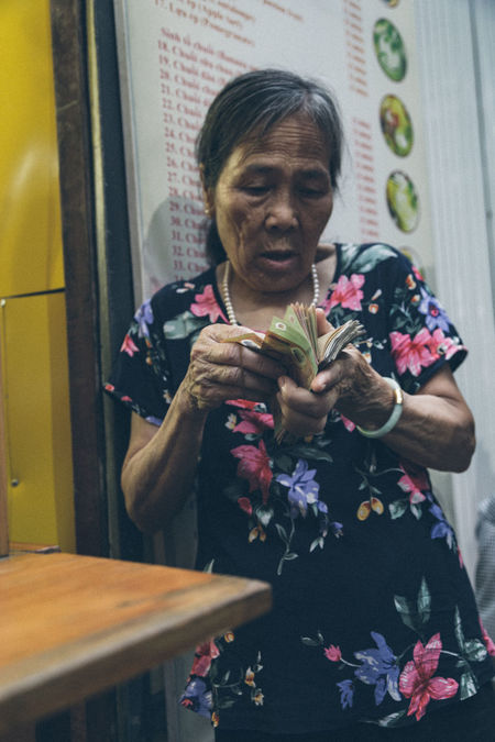 Business woman in Ha Noi, Vietnam Addiction Adult ASIA Bad Habit Business Cigar Day Finance Front View Holding Human Hand Indoors  Leisure Activity Lifestyles Money One Person People Real People Senior Adult Standing Street Streetphotography Technology Vietnam Vietnamese