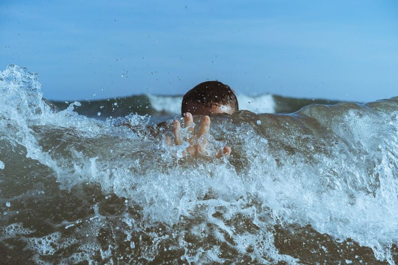 Young Man Swimming In Sea
