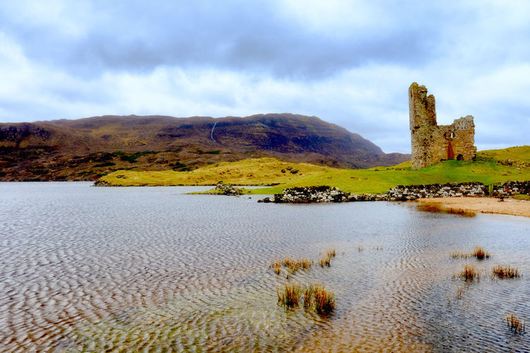 Architecture Ardvreck Castle Beauty In Nature Castle Cloud - Sky Day Highlands History Lake Mountain Nature No People Outdoors Scenics Scotland Sky Tranquil Scene Tranquility Travel Destinations Water Water Reeds